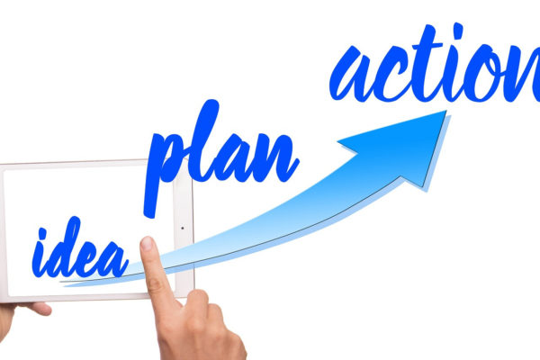 Picture showing the words idea, plan and action coming out of a tablet device